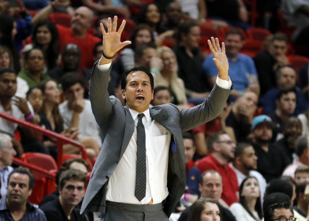 Miami Heat head coach Erik Spoelstra directs his team in the second quarter of play against the Dallas Mavericks in an NBA basketball game, Friday, De...