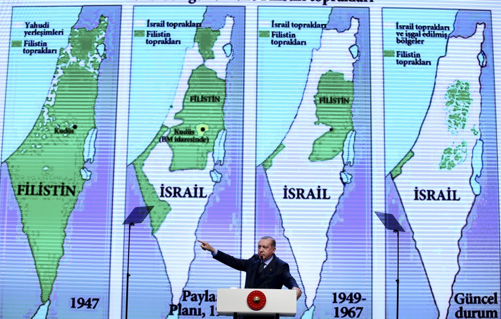 FILE- In this Saturday, Dec. 9, 2017 file photo, backdropped by maps of Israel and the Palestinian Territories, Turkey's President Recep Tayyip Erdoga...
