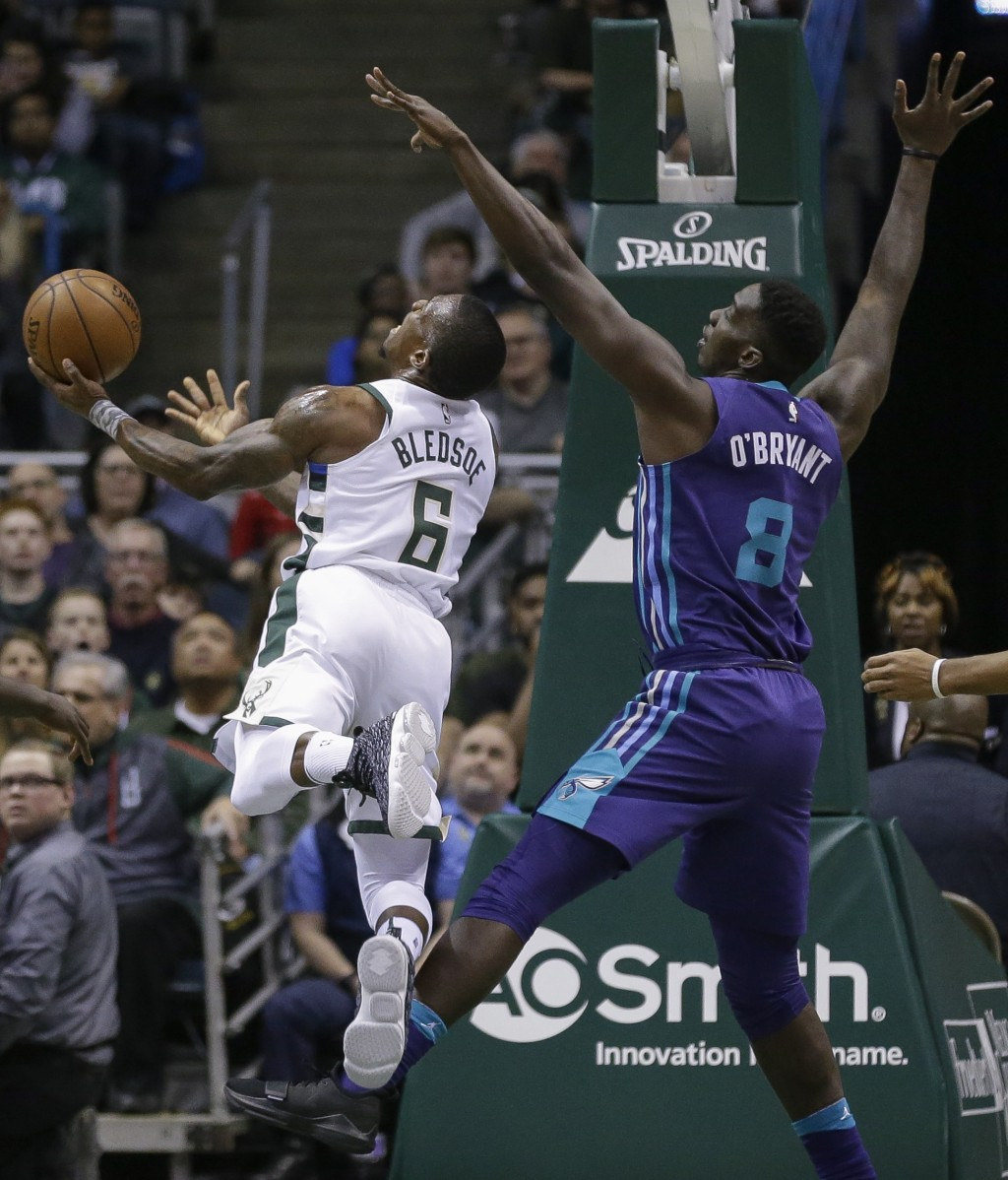 Milwaukee Bucks' Eric Bledsoe puts up a shot against Charlotte Hornets' Johnny O'Bryant III during the first half of an NBA basketball game Friday, De...