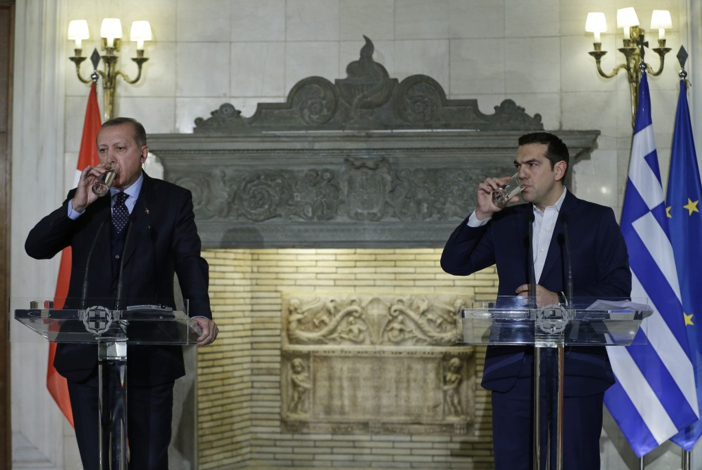 FILE-In this Thursday, Dec. 7, 2017 file photo, Greece's Prime Minister Alexis Tsipras, right and Turkey's President Recep Tayyip Erdogan, left, drink...