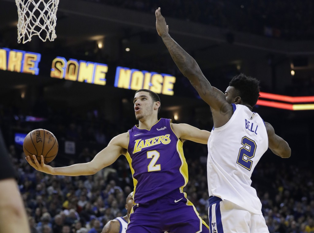 Los Angeles Lakers guard Lonzo Ball (2) drives past Golden State Warriors forward Jordan Bell (2) during the first half of an NBA basketball game Frid...