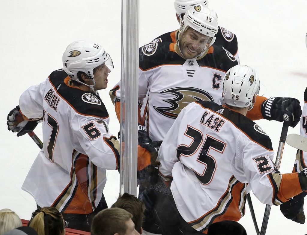Anaheim Ducks' Rickard Rakell (67) celebrates his goal in the first period of an NHL hockey game against the Pittsburgh Penguins in Pittsburgh, Saturd...