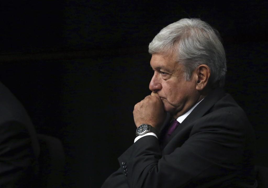 In this Monday, Nov. 20, 2017 photo, presidential hopeful Andres Manuel Lopez Obrador arrives at the National Auditorium in Mexico City. Lopez Obrador...