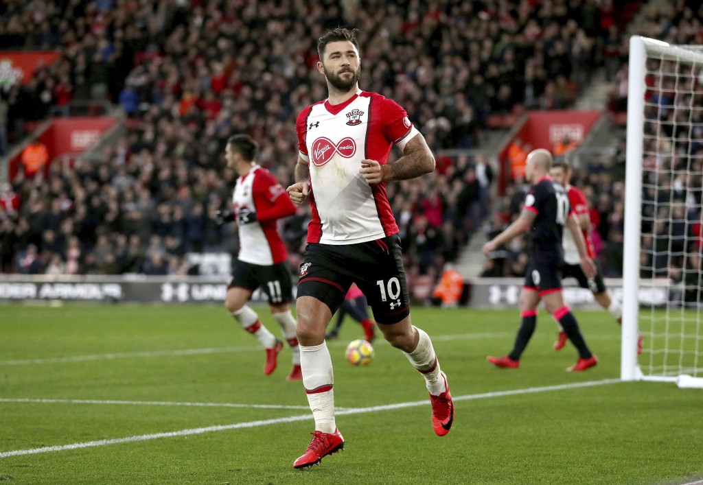 Southampton's Charlie Austin celebrates scoring his side's first goal of the game during the English Premier League soccer match between Southampton a...