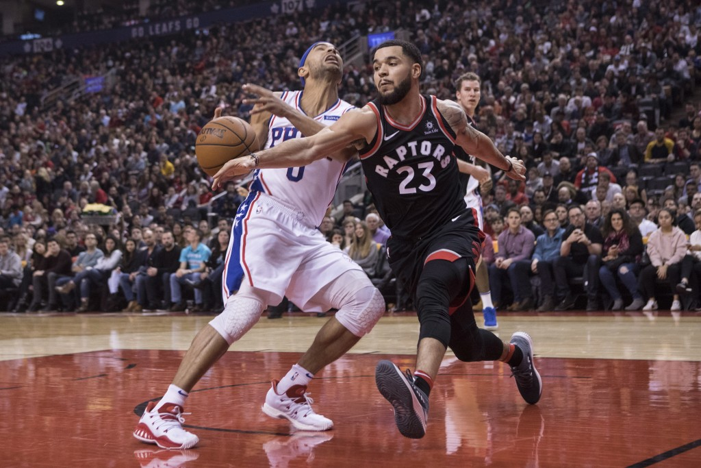 Toronto Raptors' Fred VanVleet, right, steals the ball from Philadelphia 76ers Jerryd Bayless during first half NBA basketball action in Toronto on Sa...