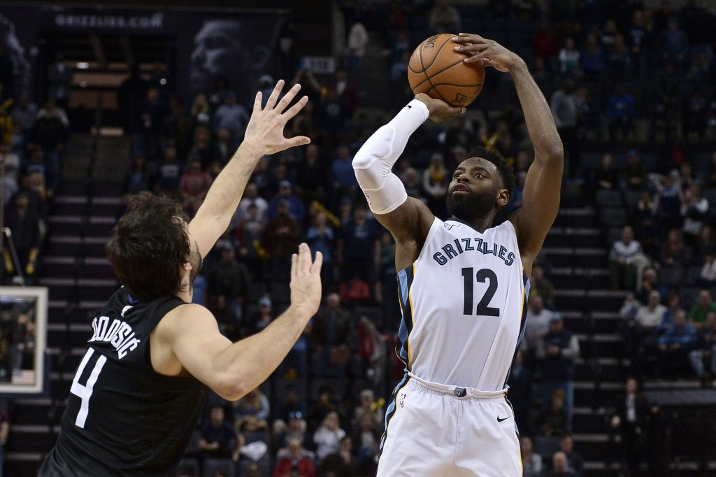 Memphis Grizzlies guard Tyreke Evans (12) attempts a three point shot against Los Angeles Clippers guard Milos Teodosic (4) in the second half of an N...