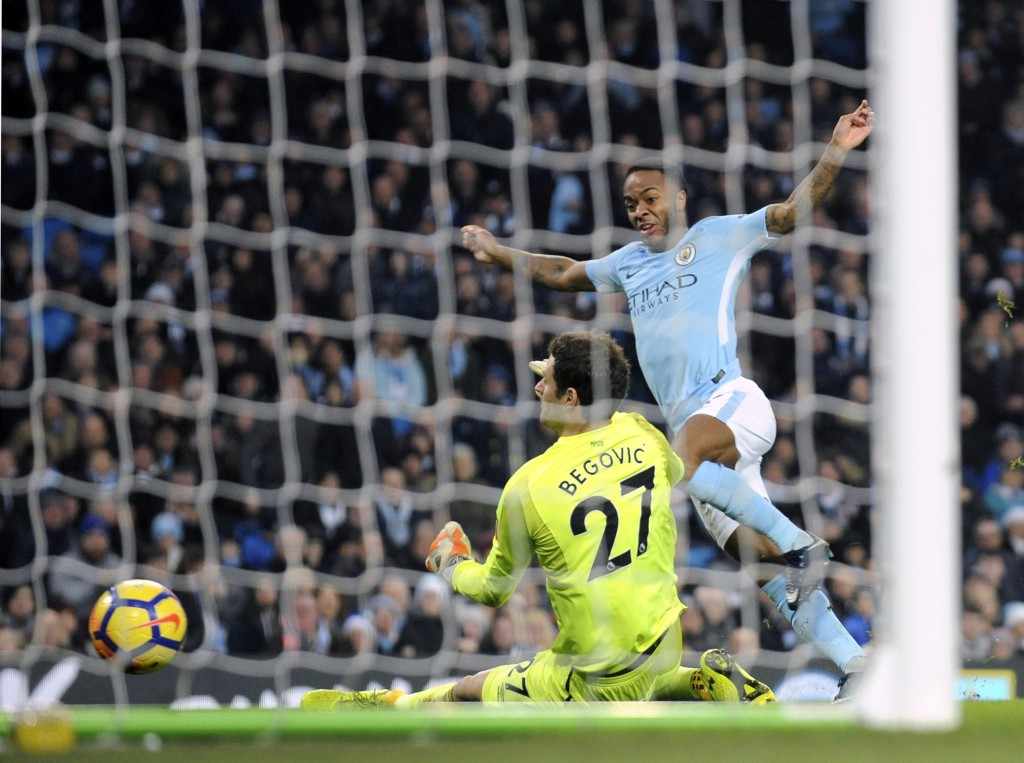 Manchester City's Raheem Sterling scores his side's second goal during the English Premier League soccer match between Manchester City and Bournemouth...
