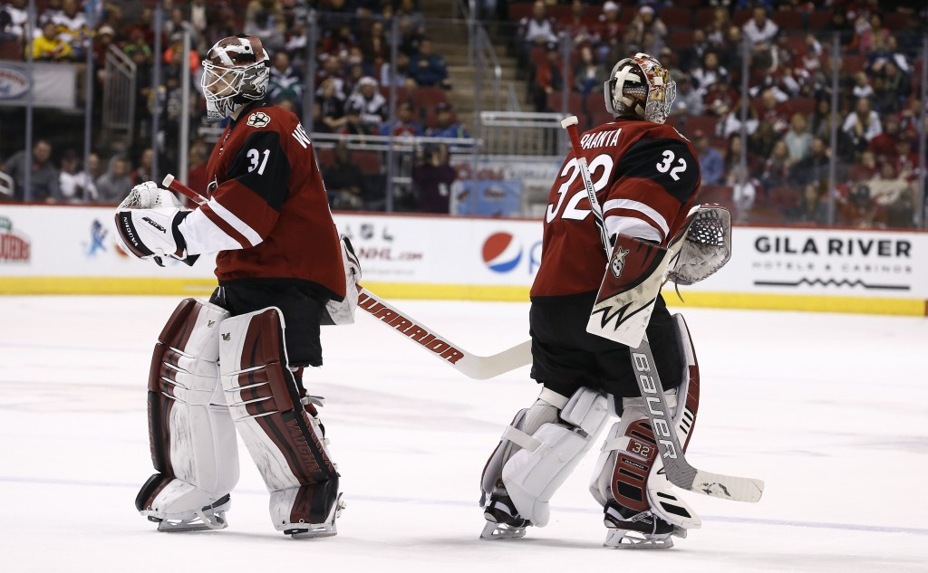 Having given up three goals to the Colorado Avalanche, Arizona Coyotes goalie Antti Raanta (32) is replaced by Scott Wedgewood (31) during the second ...