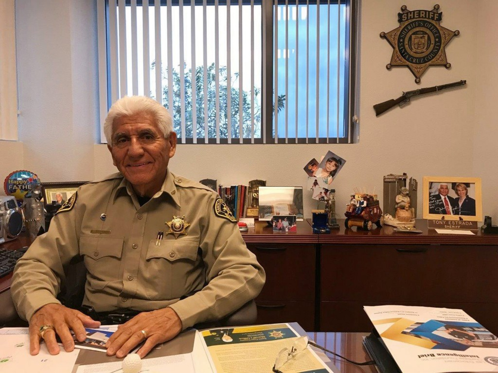 In this Dec. 5, 2017, photo, Santa Cruz County Sheriff Tony Estrada poses in his office in Nogales, Ariz. Estrada is a different kind of Arizona sheri...