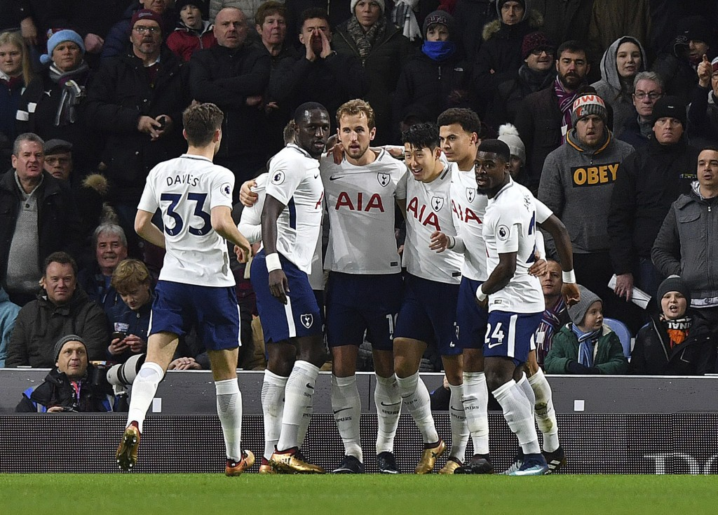 Tottenham Hotspur's Harry Kane, centre, celebrates scoring his side's first goal of the game during the English Premier League soccer match at Turf Mo...