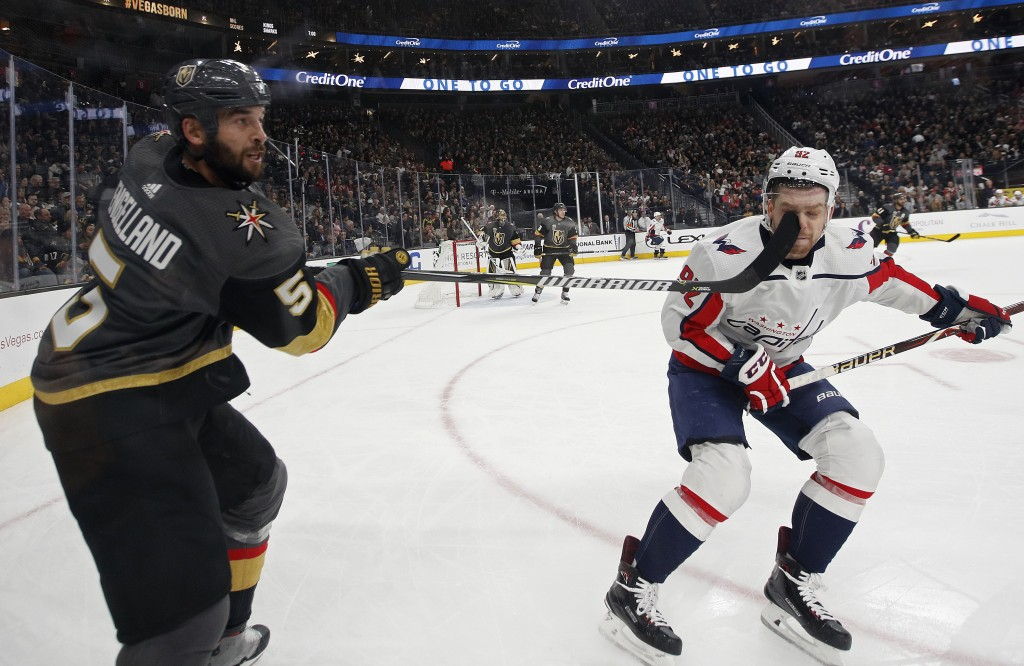 Washington Capitals center Evgeny Kuznetsov (92) is hit on the face by the stick of Vegas Golden Knights defenseman Deryk Engelland during the second ...