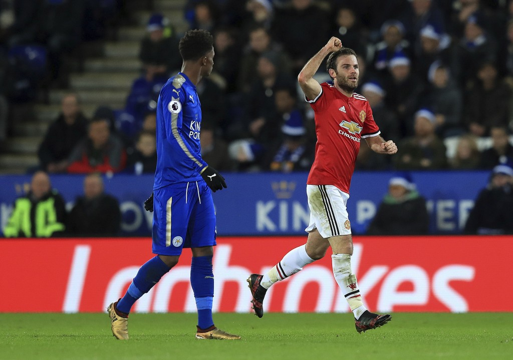 Manchester United's Juan Mata celebrates scoring his side's first goal of the game during their English Premier League soccer match against Leicester ...