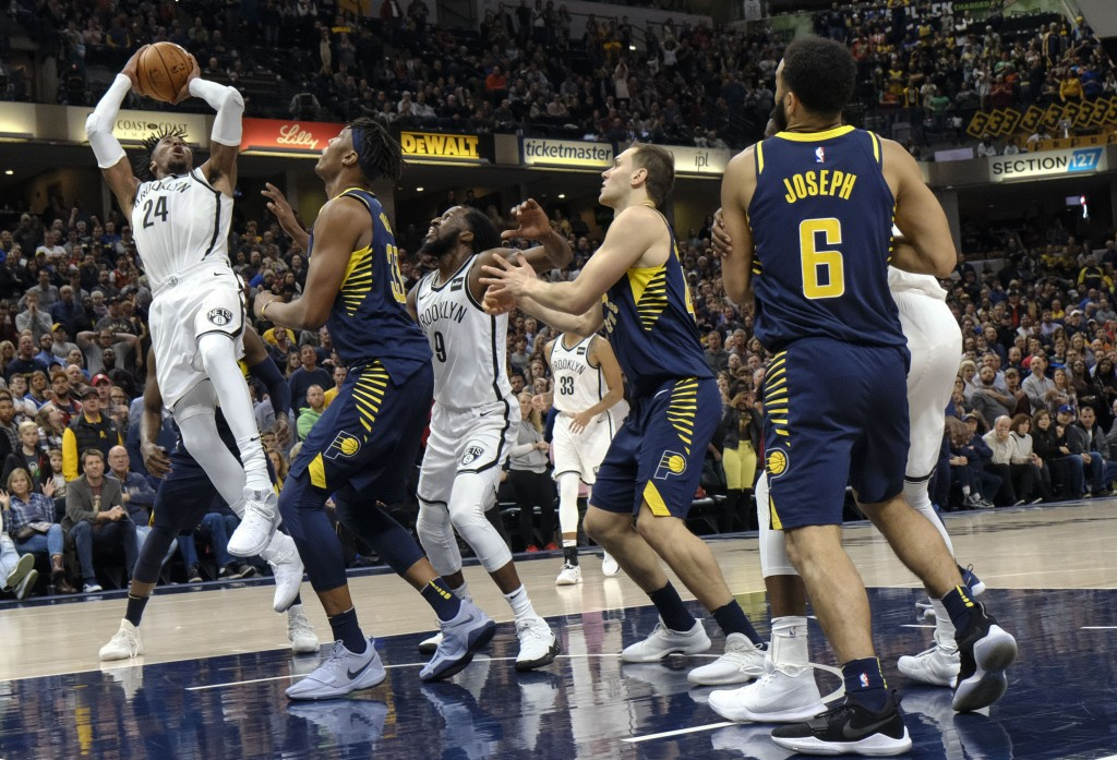 Brooklyn Nets forward Rondae Hollis-Jefferson (24) shoots over Indiana Pacers center Myles Turner (33) during the second half of an NBA basketball gam...