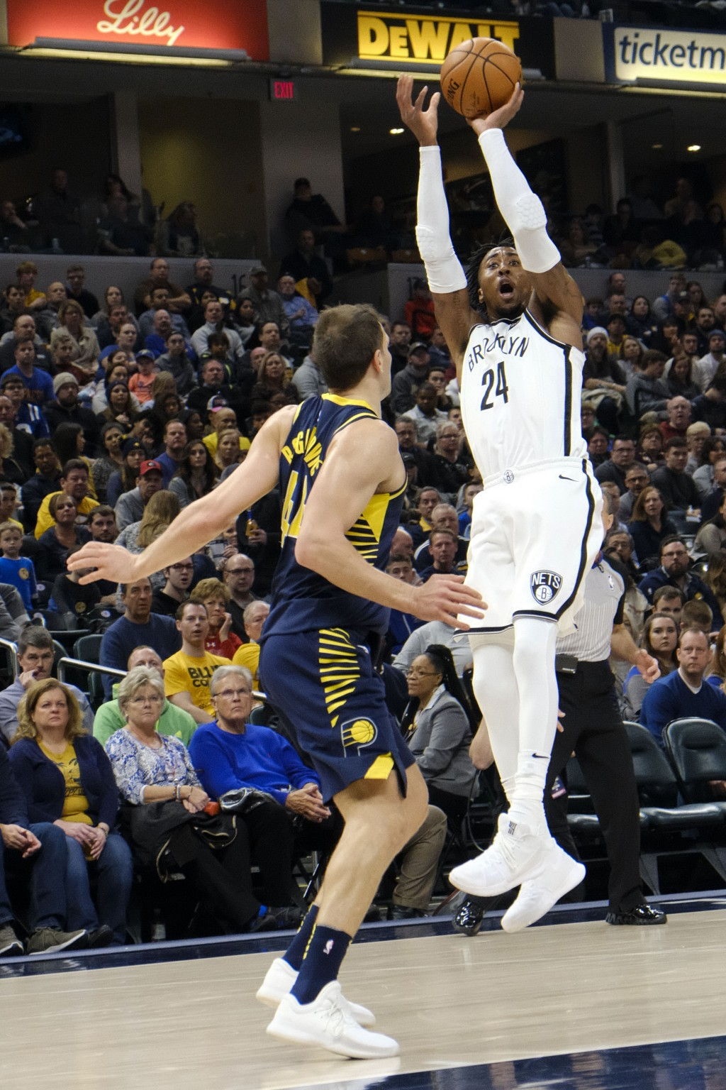 Brooklyn Nets forward Rondae Hollis-Jefferson (24) shoots over Indiana Pacers forward Bojan Bogdanovic (44) during the second half of an NBA basketbal...