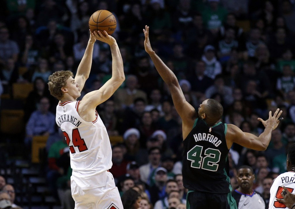 Chicago Bulls' Lauri Markkanen (24) shoots over Boston Celtics' Al Horford during the second quarter of an NBA basketball game in Boston on Saturday, ...
