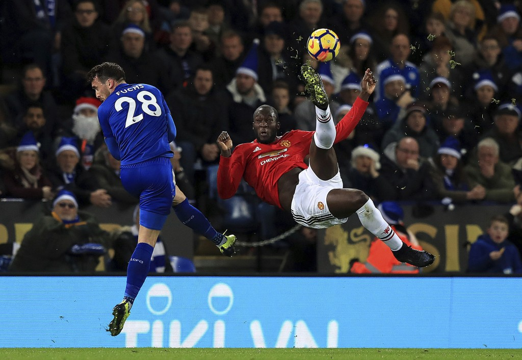 Leicester City's Christian Fuchs, left, and Manchester United's Romelu Lukaku battle for the ball during their English Premier League soccer match at ...