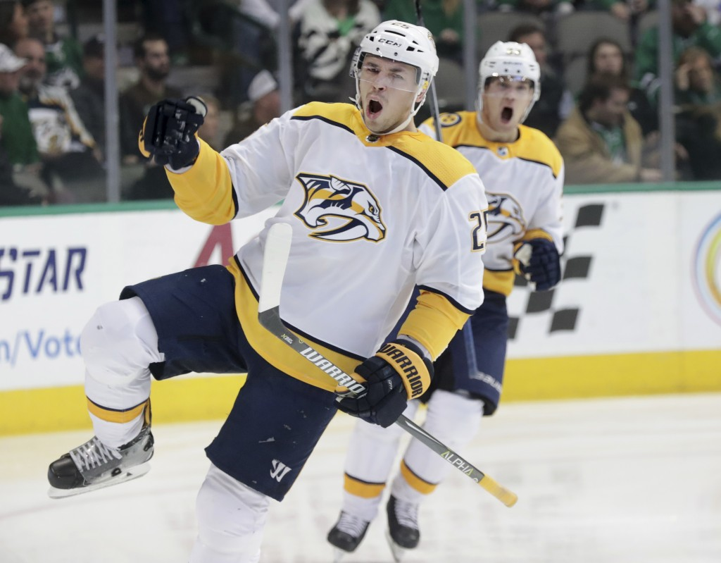Nashville Predators defenseman Alexei Emelin (25) celebrates his goal in front of teammate Viktor Arvidsson (33) during the first period of an NHL hoc...