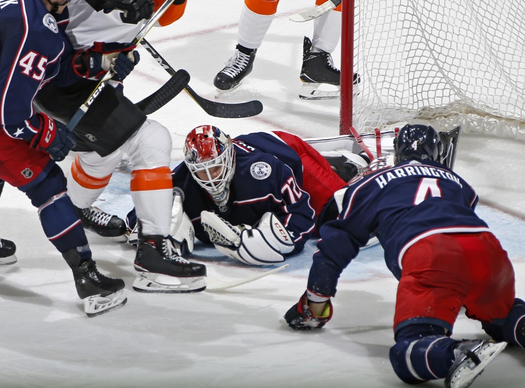Columbus Blue Jackets goalie Sergei Bobrovsky (72) makes a save against Philadelphia Flyers during the second period of an NHL hockey game in Columbus...