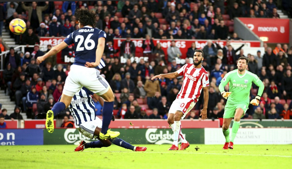 Stoke City's Eric Maxim Choupo-Moting, center, scores his side's second goal of the game during the English Premier League soccer match at the Bet365 ...