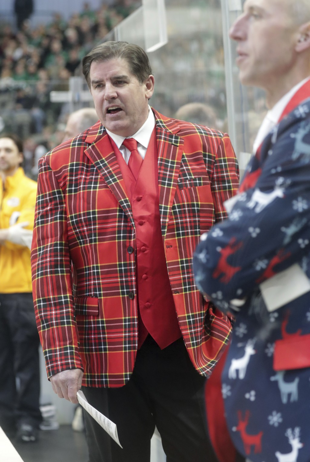 Nashville Predators head coach Peter Laviolette looks on from the bench during the first period of an NHL hockey game against the Dallas Stars in Dall...