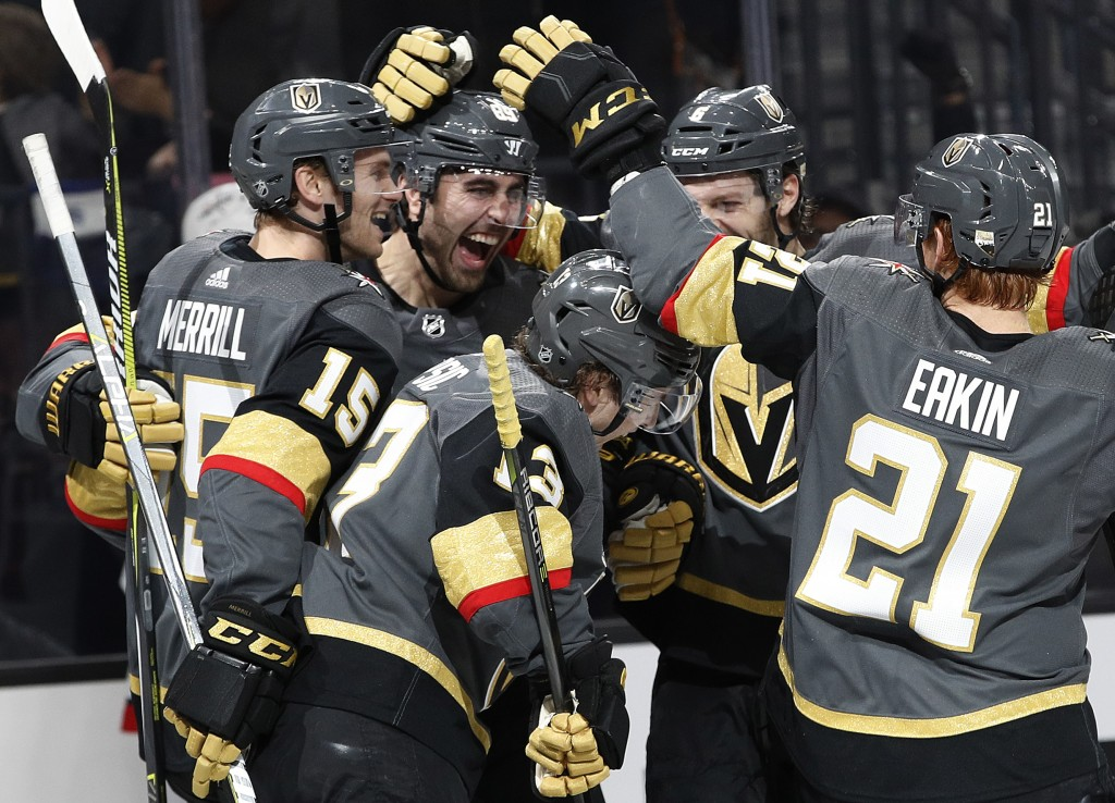 Vegas Golden Knights players celebrate after Vegas right wing Alex Tuch, second from left, scored against the Washington Capitals during the first per...