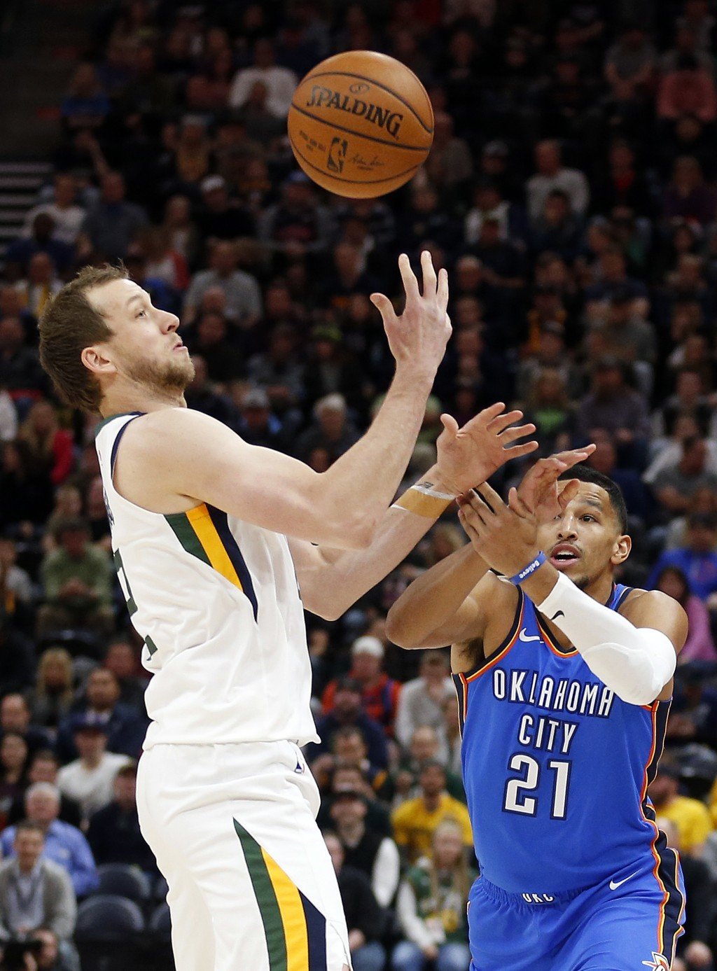 Utah Jazz forward Joe Ingles, left, knocks the ball away from Oklahoma City Thunder guard Andre Roberson (21) in the first half during an NBA basketba...