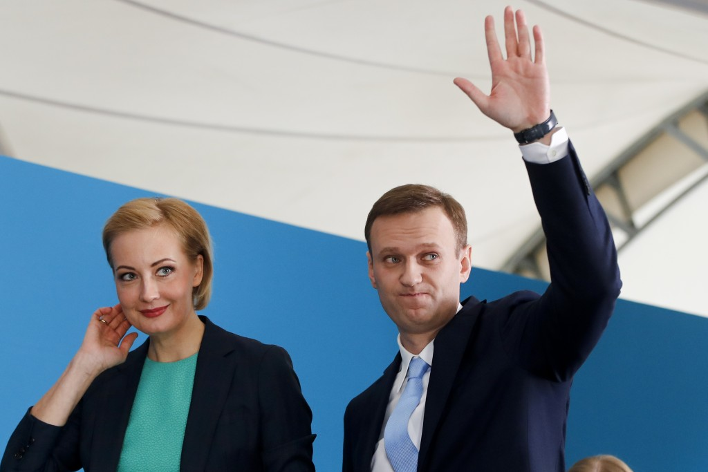 Russian opposition leader Alexei Navalny and his wife Yulia attend his supporters' meeting that nominated him for the presidential election race in Mo...