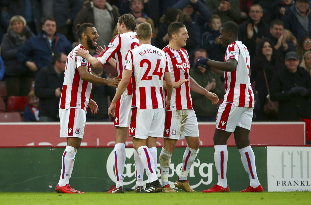 Stoke City's Eric Maxim Choupo-Moting celebrates scoring his side's second goal of the game with team mates during the English Premier League soccer m...