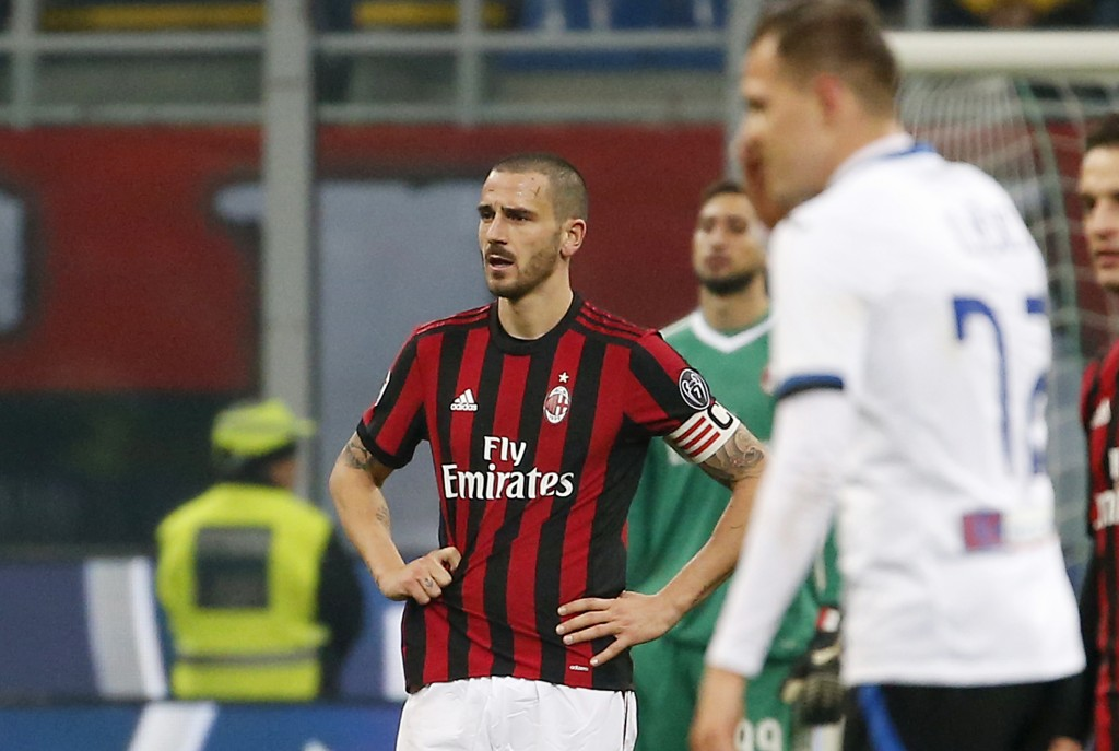 AC Milan's Leonardo Bonucci, left, stands on the pitch after Atalanta's Josip Ilicic scored his side's second goal during the Serie A soccer match bet...
