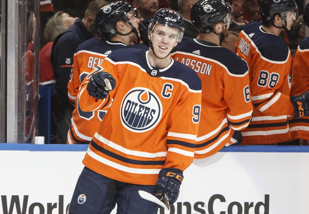 Edmonton Oilers' Connor McDavid (97) celebrates a goal against the Montreal Canadiens during first-period NHL hockey game action in Edmonton, Alberta,...