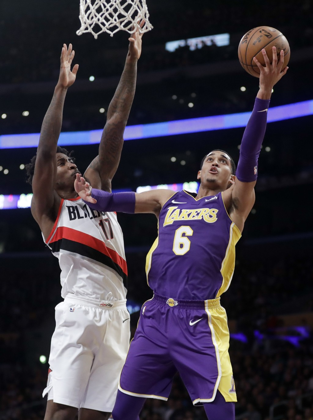 Los Angeles Lakers guard Jordan Clarkson shoots around Portland Trail Blazers forward Ed Davis during the first half of an NBA basketball game in Los ...