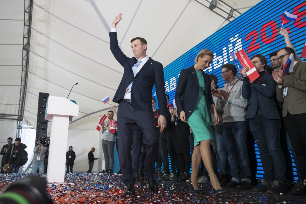 Russian opposition leader Alexei Navalny greets his supporters at a meeting that nominated him for the presidential election race in Moscow, Russia, S...