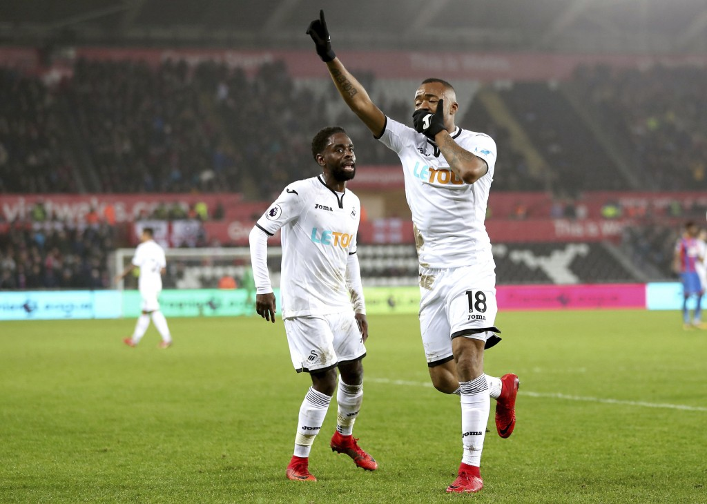 Swansea City's Jordan Ayew celebrates scoring his side's first goal of the game during the English Premier League soccer match against Crystal Palace ...