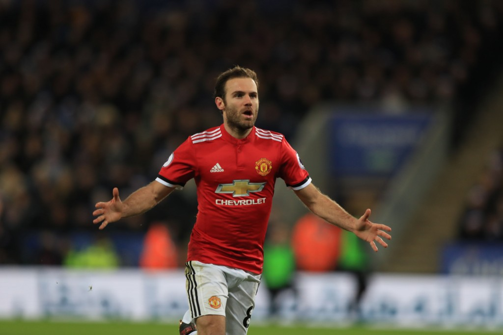Manchester United's Juan Mata celebrates scoring his side's second goal of the game during their English Premier League soccer match against Leicester...
