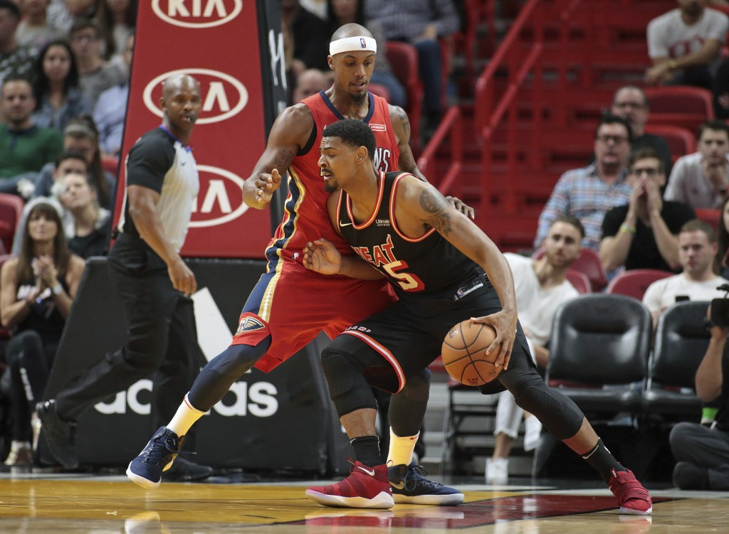 Miami Heat center Jordan Mickey (25) runs into New Orleans Pelicans forward Dante Cunningham (33) as he drives to the basket during the first half of ...