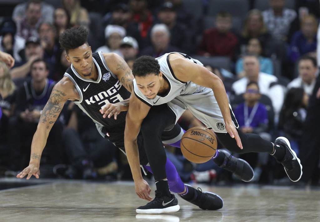Sacramento Kings guard Malachi Richardson (23) and San Antonio Spurs guard Bryn Forbes (11 )go after a loose ball during the first half of an NBA bask...