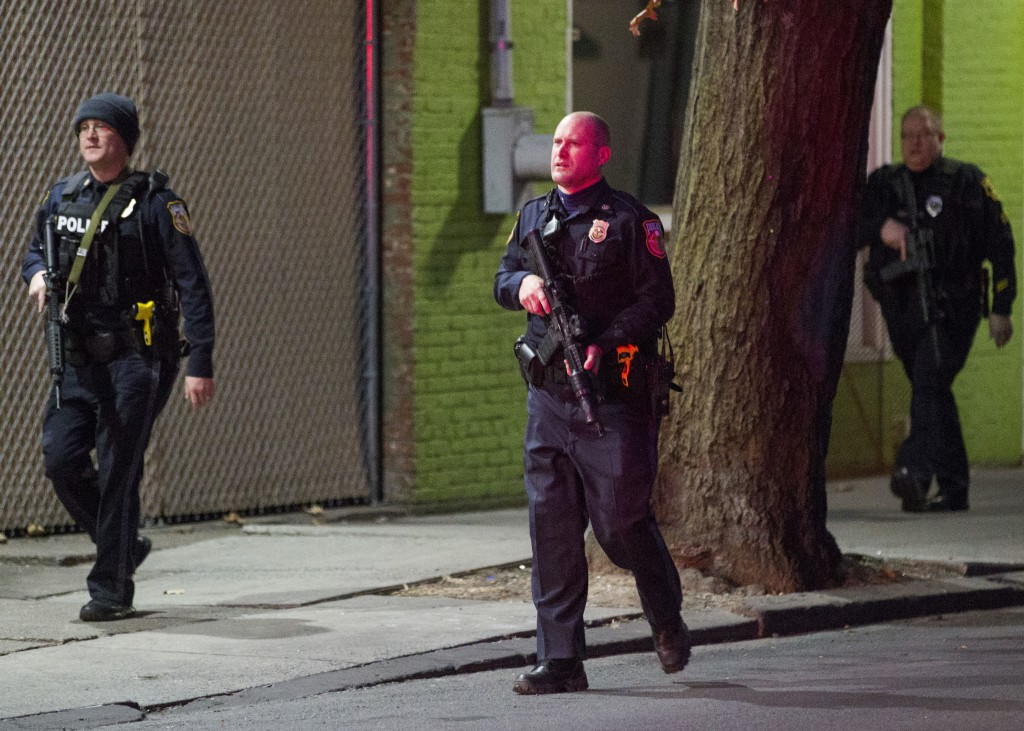 """Harrisburg Police block off sections of the street after a shooting, Friday, Dec. 22, 2017.  A prosecutor says there's """"no doubt"""" a gunman who fired a..."""