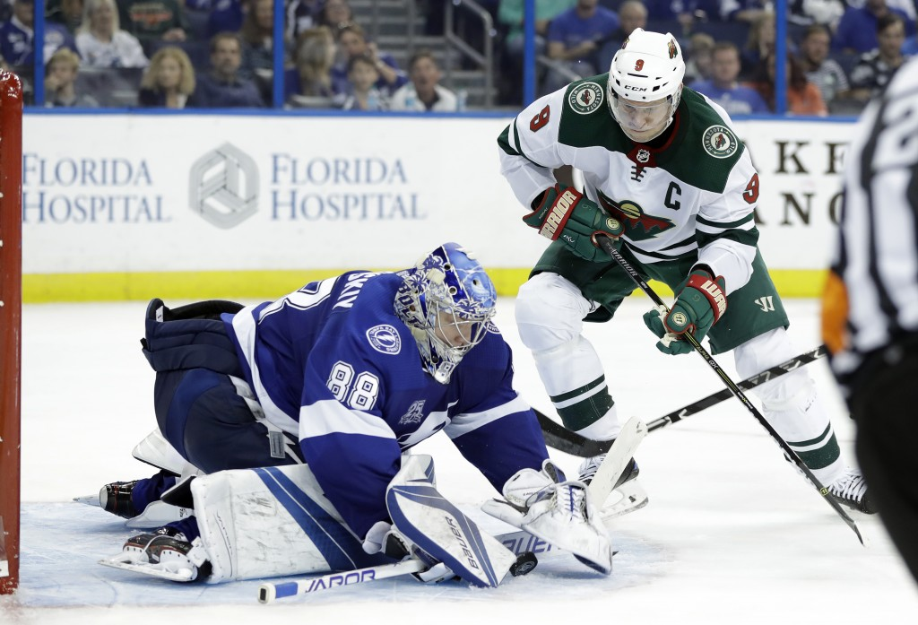 Tampa Bay Lightning goalie Andrei Vasilevskiy (88) covers up on a shot by Minnesota Wild center Mikko Koivu (9) during the third period of an NHL hock...