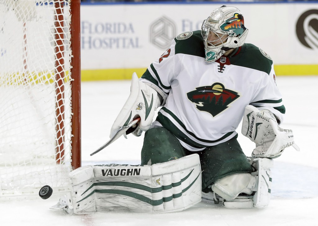 Minnesota Wild goalie Alex Stalock makes a save on a shot by the Tampa Bay Lightning during the second period of an NHL hockey game Saturday, Dec. 23,...