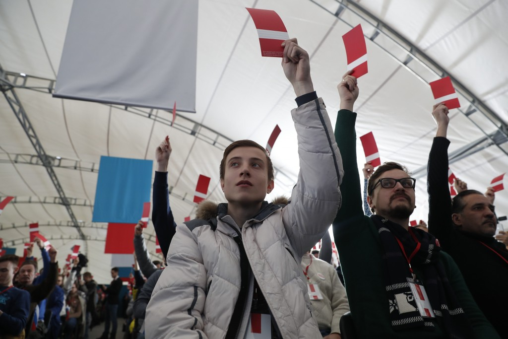 Supporters of Russian opposition leader Alexei Navalny vote during a meeting that their candidate for the presidential election race is nominated in M...