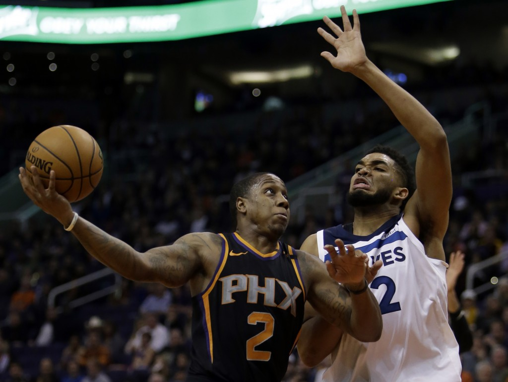 Phoenix Suns guard Isaiah Canaan (2) shoots over Minnesota Timberwolves center Karl-Anthony Towns in the third quarter during an NBA basketball game, ...