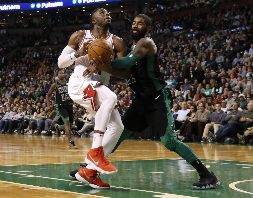 Boston Celtics' Kyrie Irving, right, stops Chicago Bulls' David Nwaba from getting to the basket during the fourth quarter of Boston's 117-92 win in a...