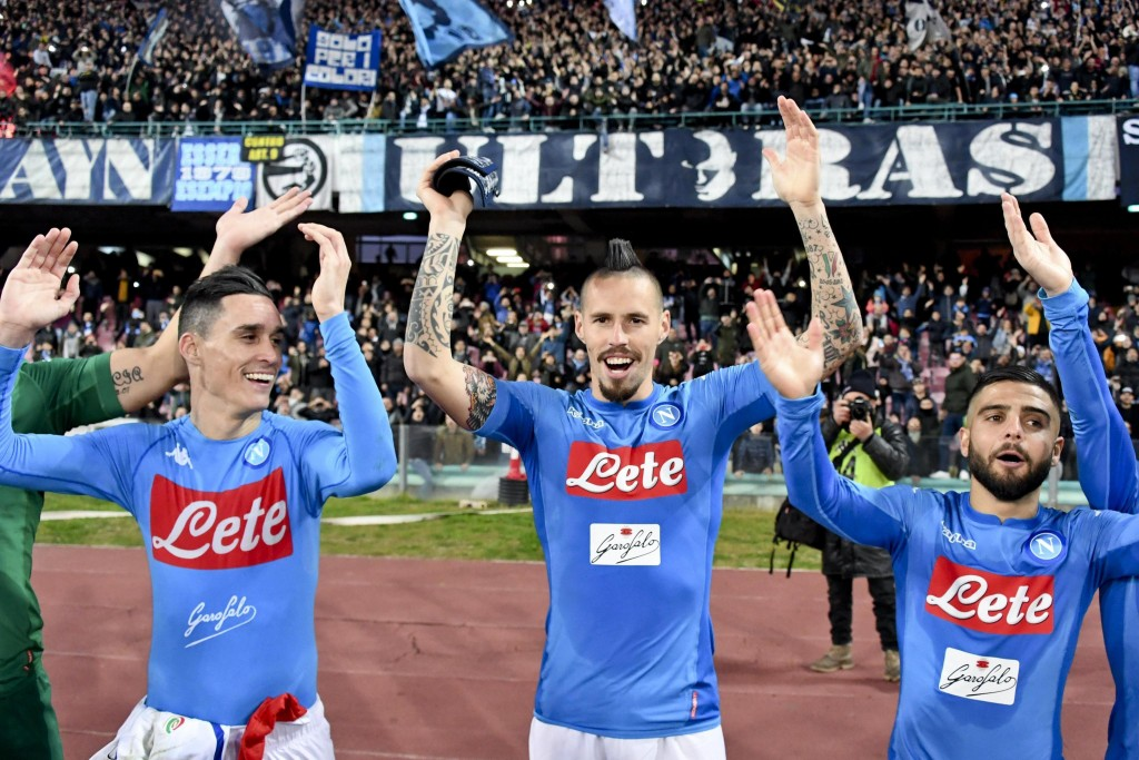 Napoli's Marek Hamsik, center, celebrates with his teammates Jose Callejon, left, and Lorenzo Insigne at the end of the Italian Serie A soccer match a...
