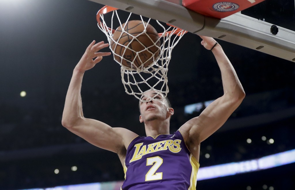 Los Angeles Lakers guard Lonzo Ball dunks against the Portland Trail Blazers during the first half of an NBA basketball game in Los Angeles, Saturday,...