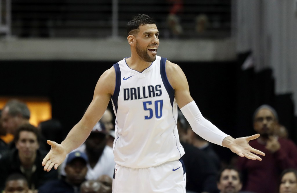 Dallas Mavericks' Salah Mejri, of Tunisia, reacts after being called for technical foul in the third quarter of an NBA basketball game against the Atl...