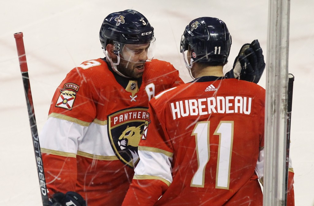 Florida Panthers' Jonathan Huberdeau (11) celebrates with teammate Keith Yandle (3) after scoring a goal against the Ottawa Senators during the second...