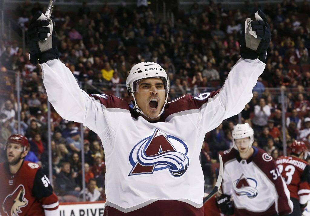 Colorado Avalanche right wing Nail Yakupov celebrates his goal against the Arizona Coyotes during the second period of an NHL hockey game, Saturday, D...