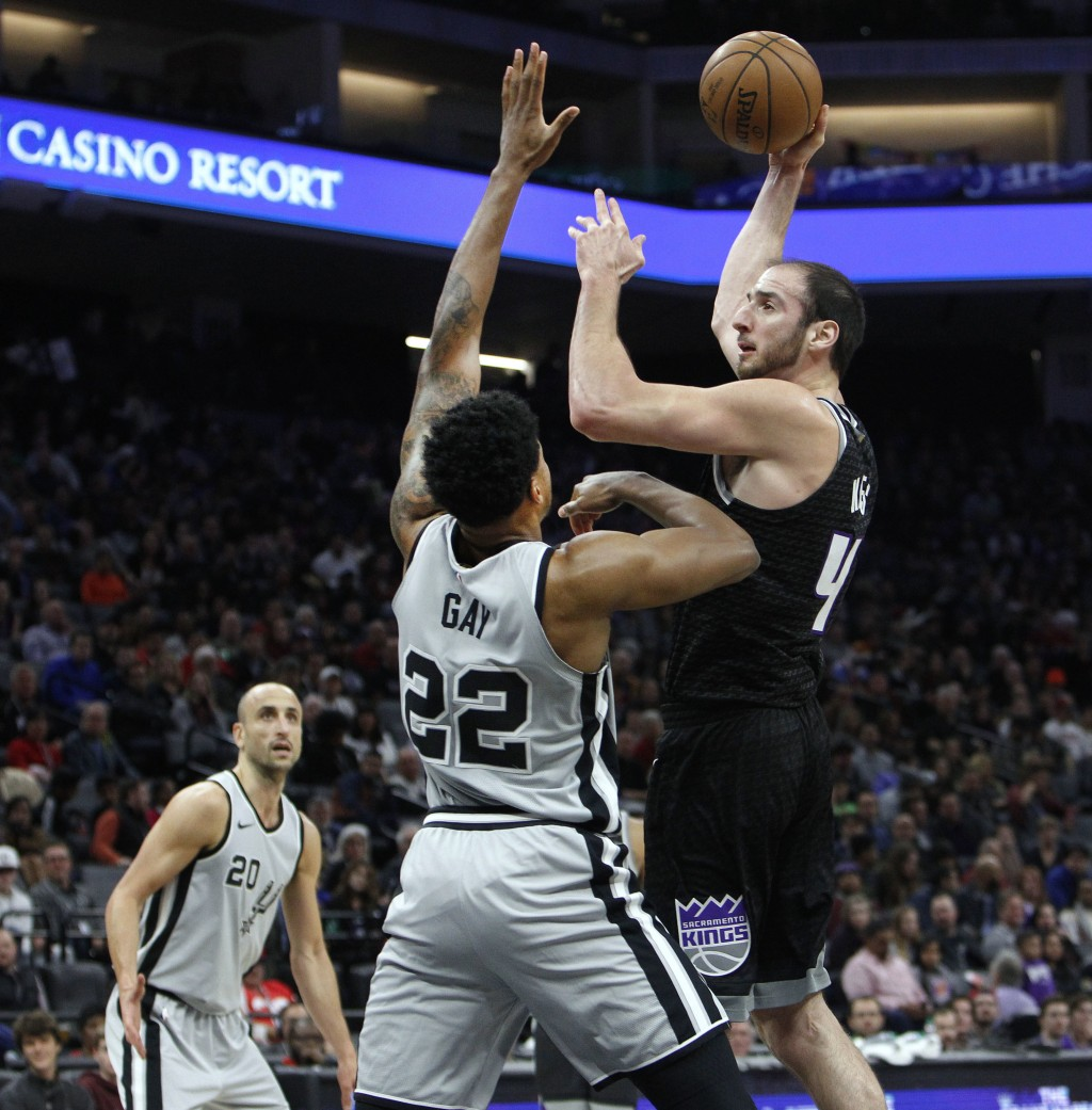 Sacramento Kings center Kosta Koufos (41) shoots over San Antonio Spurs forward Rudy Gay (22) during the first half of an NBA basketball game in Sacra...