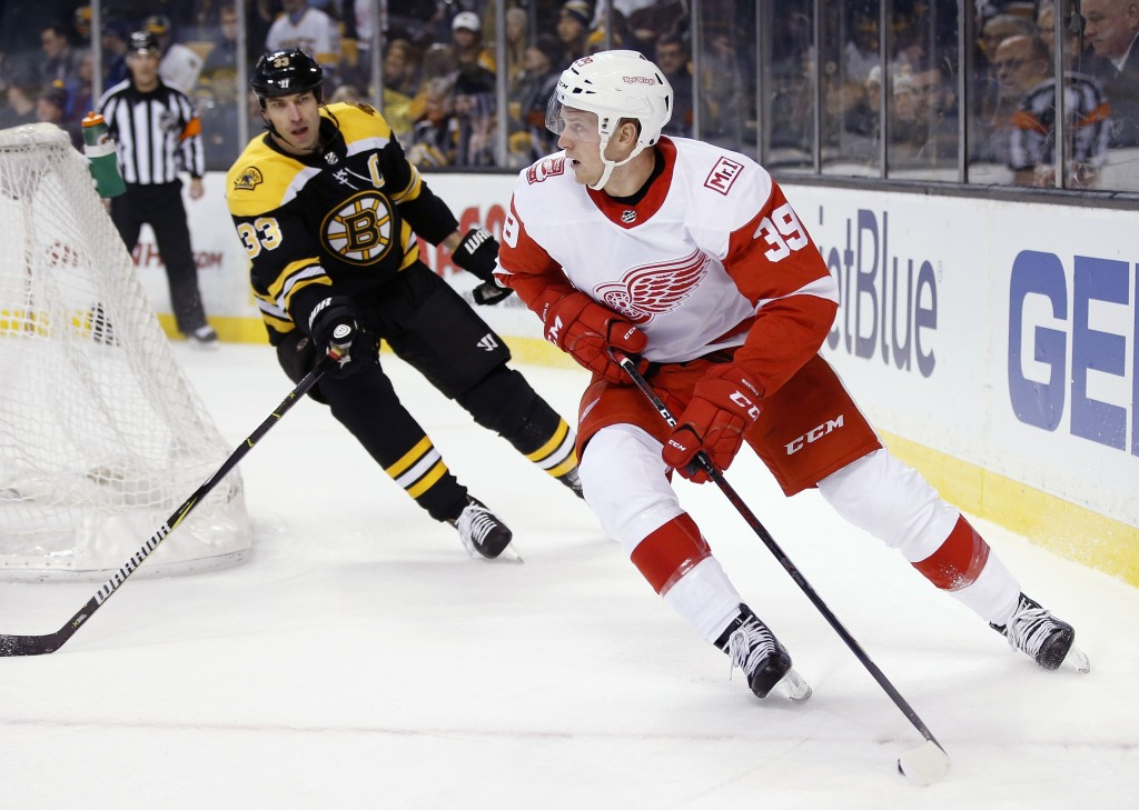 Boston Bruins' Zdeno Chara (33), of Slovakia, pursues Detroit Red Wings' Anthony Mantha (39) behind the net during the first period of an NHL hockey g...