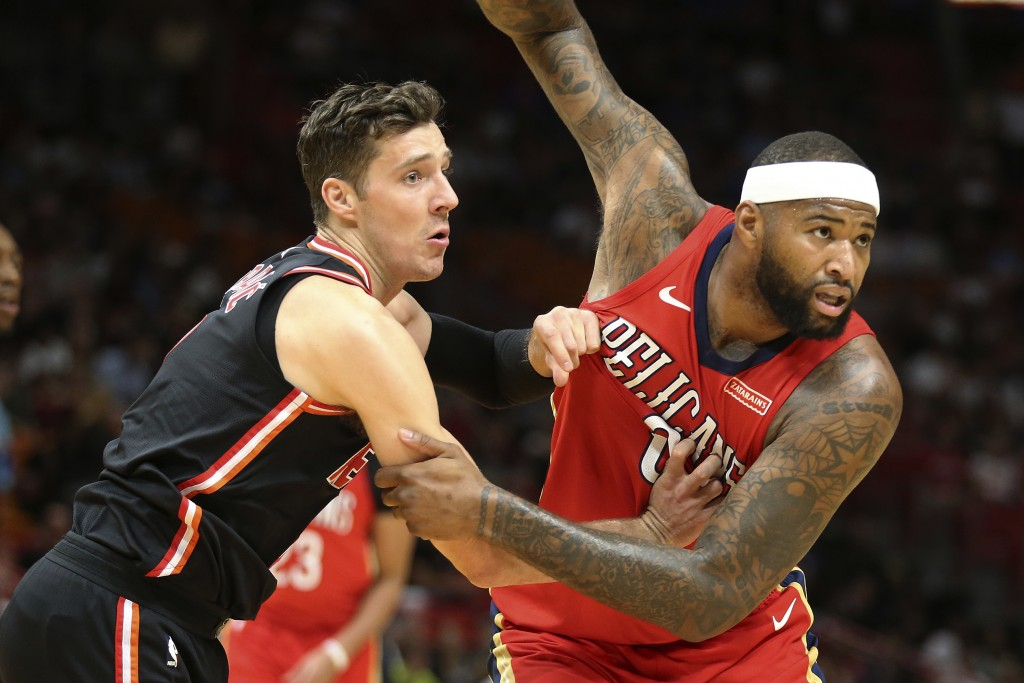New Orleans Pelicans forward DeMarcus Cousins (0) and Miami Heat guard Goran Dragic (7) battle under the basket for position during the first half of ...
